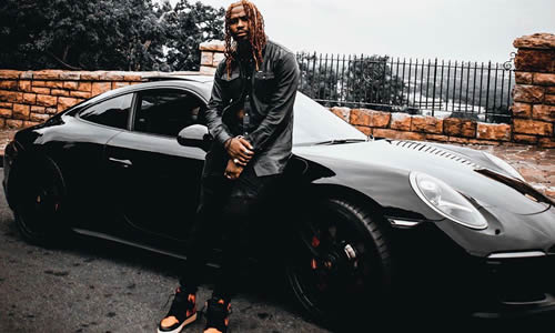 Stilo Magolide standing next to his new Mazda MX-5 car